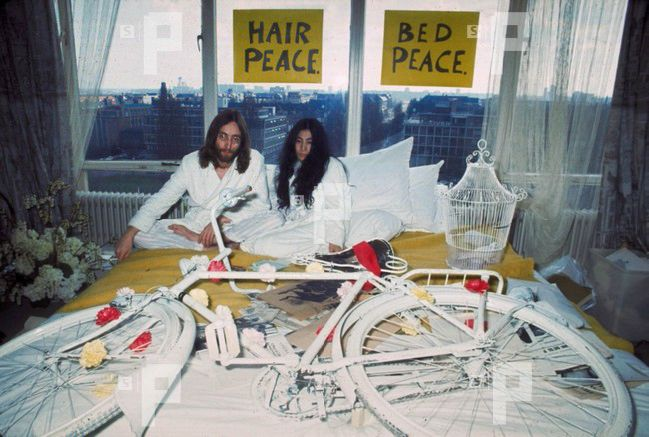 John Lennon and Yoko Ono with the Provo bike on their bed that was given to them by Hans Hoffmann during Bed-in for Peace, Hilton Hotel, Amsterdam, March 27, 1969. Source: National Archive / Spaarnestad Photo Archive