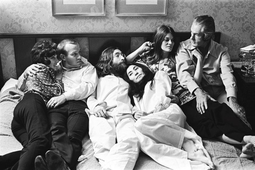 Yoko Ono and John Lennon in bed with Timothy Leary and others during Bed-In Montreal, 1969. Photo: Stephen Sammons