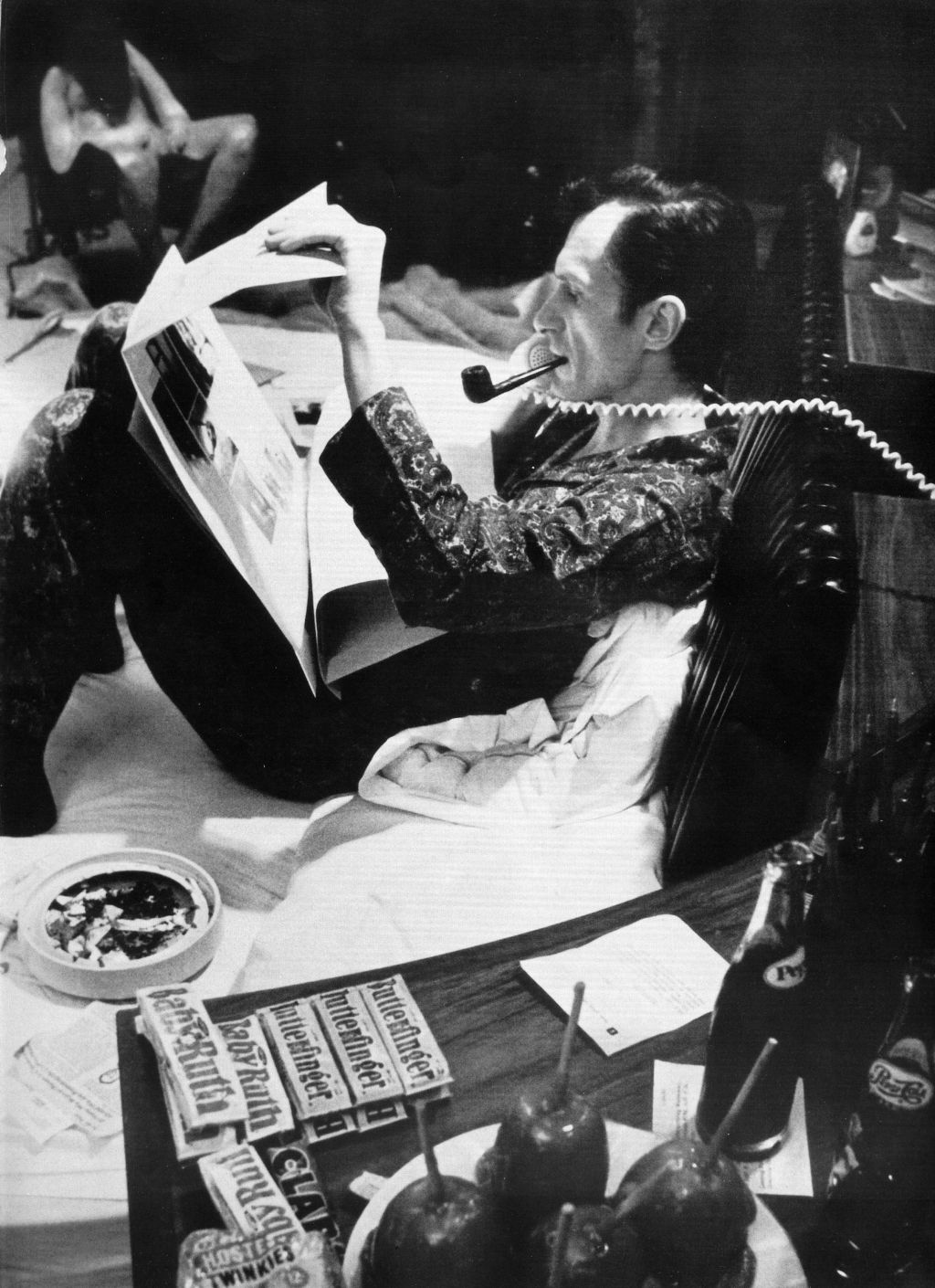 Hugh Hefner in bed at work with array of stimulants at the Playboy Mansion in Chicago. Copyright: Playboy Enterprises International, Inc.